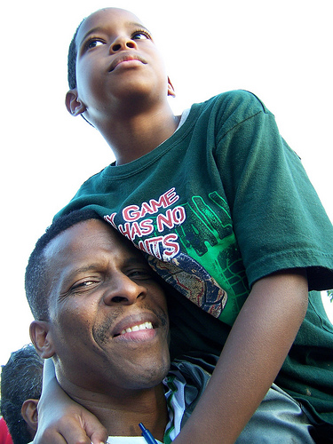 Father and son attending the Barack Obama campaign rally at Amway Arena in Orlando, Florida. Picture by Rob McCullough