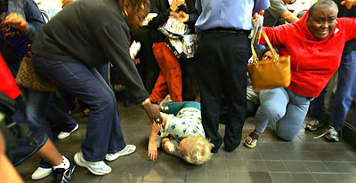 Woman trampled at doorbuster sale.