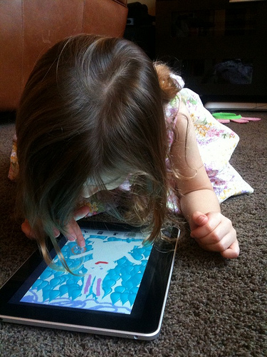 Girl drawing bunny on Apple iPad, photo by Matt Haughey