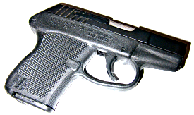 Photo of handgun by Robert Nelson, licensed under Creative Commons