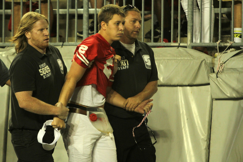 Ohio State student tackled on field by coach