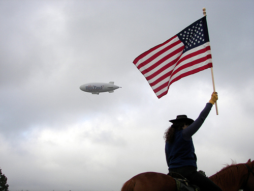 Photo of Ron Paul Blimp and flag-waving supporter by Madwurm
